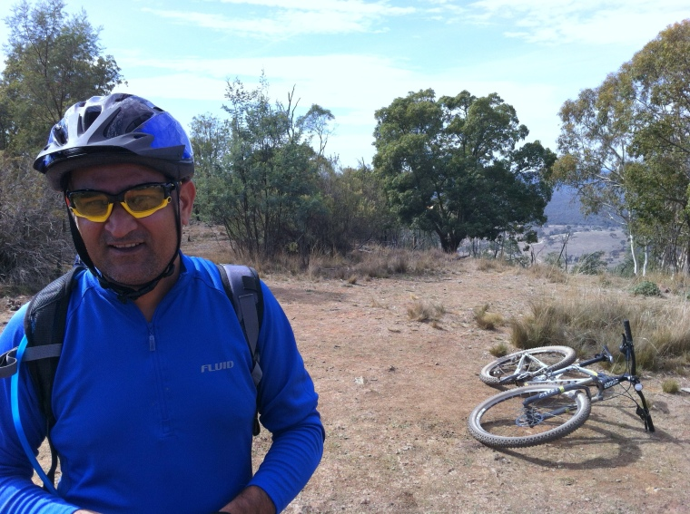 Amandeep on Mt Majura.  Trusty bike on background.