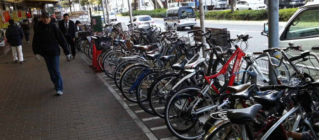 Bicycle Parking -Sannomiya Kobe.  Suddenly there's a footpath to walk down!